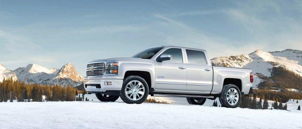 2015 Chevy Silverado side view in snow.