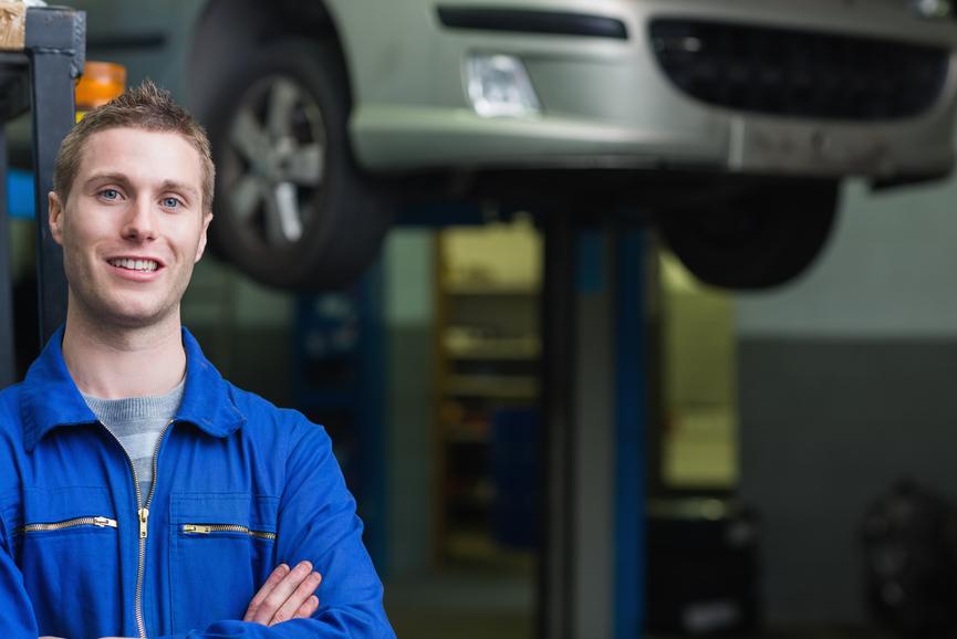 Auto mechanic in workshop