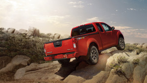 2016 nissan frontier lava red winter driving
