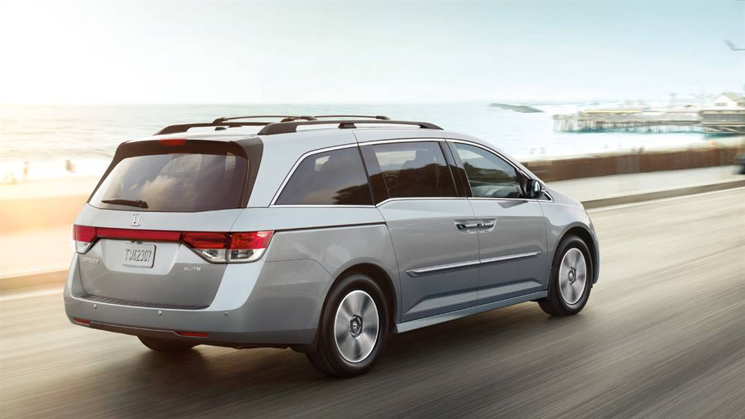 2017 Honda Odyssey driving down the highway