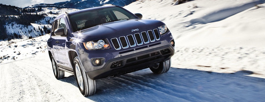 2016 Jeep Compass driving on the snow