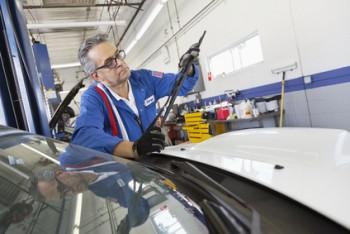 Senior mechanic working on windshield wipers
