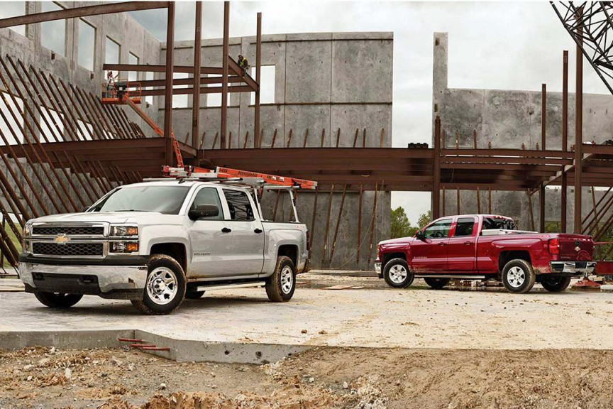 2015 Silverado 1500 trucks on work site