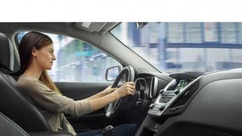 Woman Driving Chevy Equinox