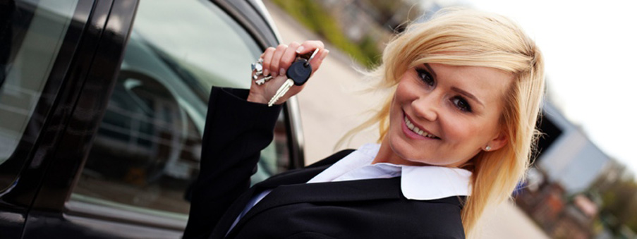 Smiling woman with car keys
