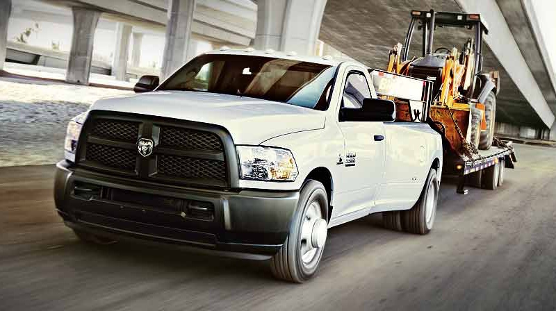 white 2016 Ram 3500 on the road