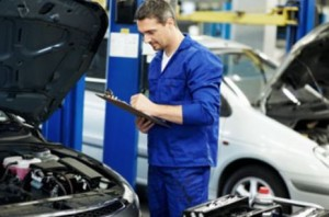 Mechanic Inspecting Certified Pre-owned Ford Vehicles Louisville KY