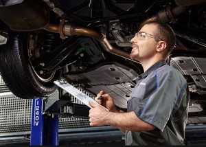 Technician Inspecting Certified Preowned Ford Truck Louisville KY