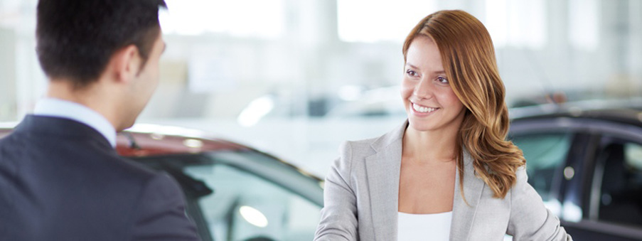 car dealer handshaking